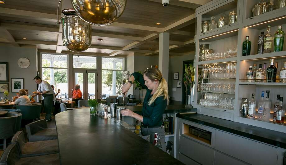 Bartender Marie Hooten makes a cocktail in the bar at Acacia House in St. Helena. Photo: John Storey, Special To The Chronicle