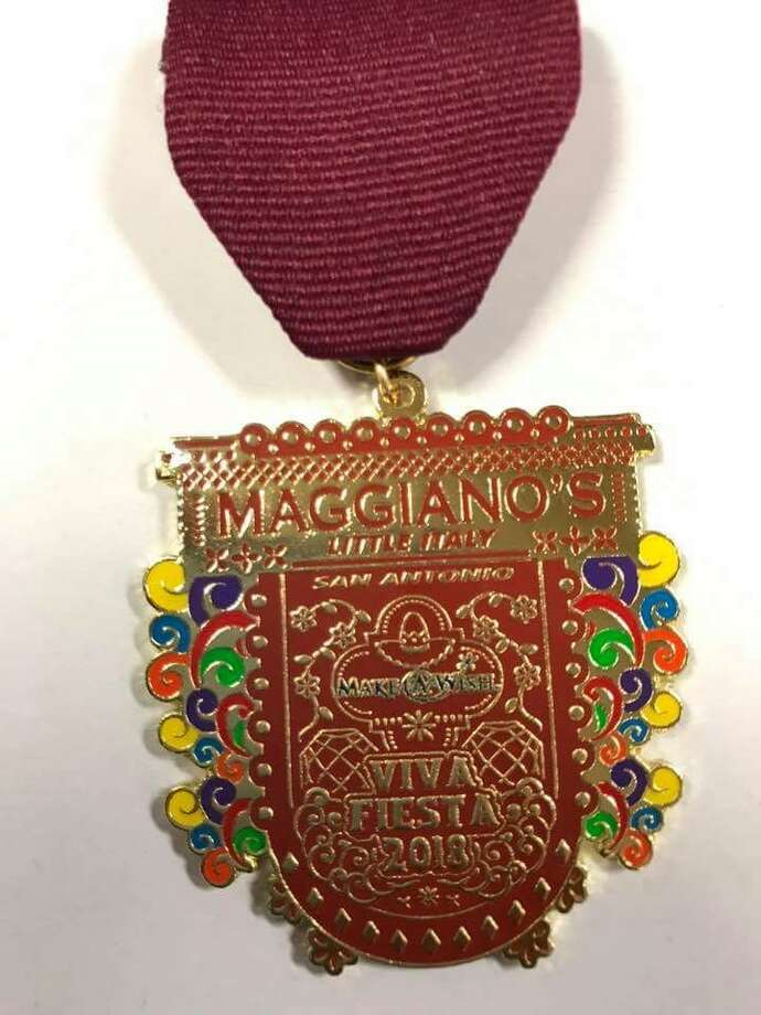 Maggiano's Little Italy is one of the first companies to have a medal completed already.   Eddie Ortiz, maitre d' of the 17603 Interstate 10 location, worked with his friend Martin Salazar to create next year's medal which is already going for $20.