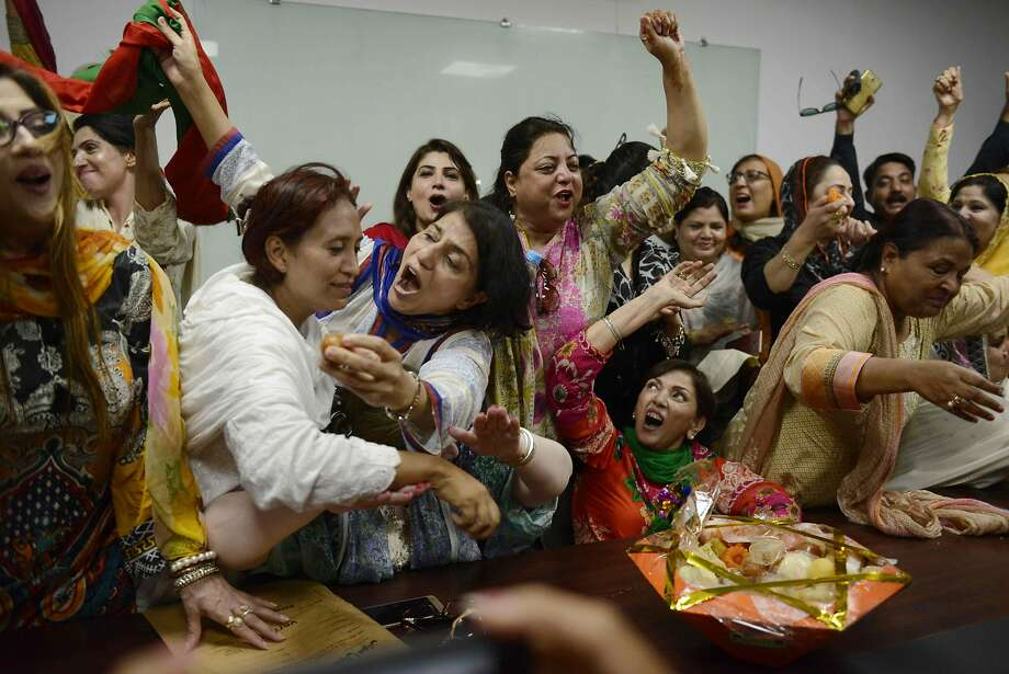 Opposition activists celebrate the Supreme Court decision to disqualify Prime Minister Nawaz Sharif from office in Lahore. The ruling came after an investigation into his family's finances. Photo: ARIF ALI, AFP/Getty Images