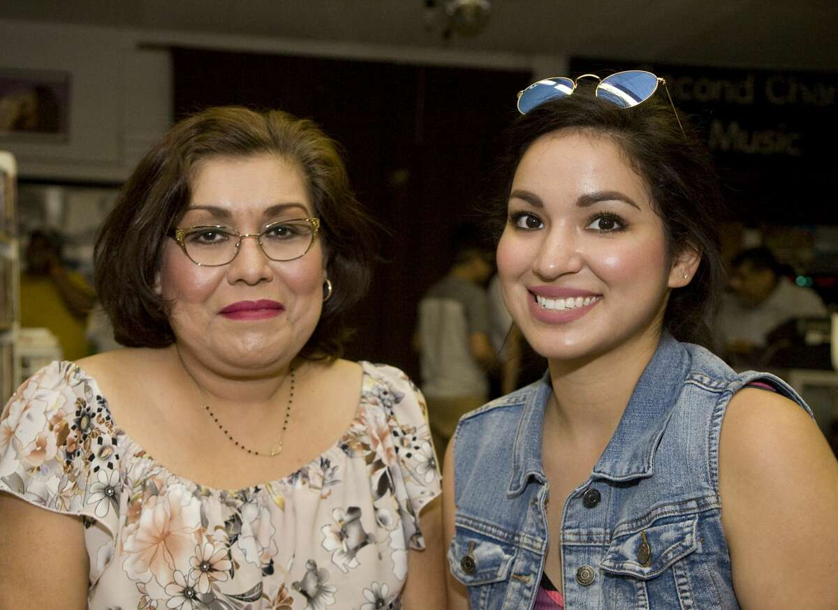 Carmen and Laura Rodriguez at Second Chance Music Store.