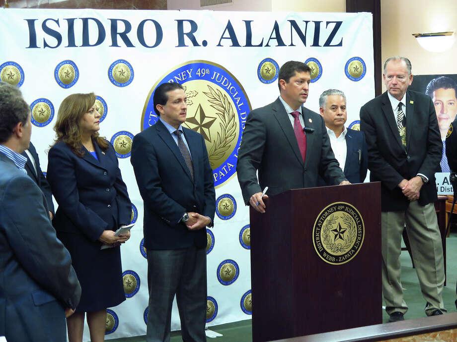 "Webb/Zapata County District Attorney Isidro ""Chilo"" Alaniz is shown at a podium. Photo: Cuate Santos/Laredo Morning Times"
