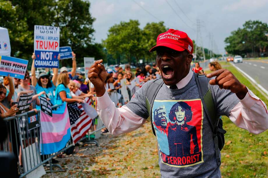A supporter of President Trump confronts protesters who had gathered at Suffolk County Community College in Selden, N.Y., for the president's speech. Photo: EDUARDO MUNOZ ALVAREZ, AFP/Getty Images