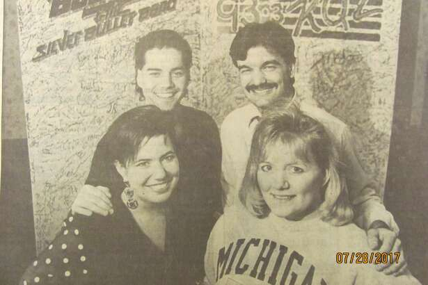 WKQZ-FM 93.3 wants rock n roller Bob Seger to play at the Saginaw Civic Center. So they're asking him to. WKQZ personalities, clockwise from front left, Stacy Latona, Marc Arturi, Joe Volk and Connie Schilkey-Kitts are asking fans to sign a huge card (pictured) to be hand-delivered to Seger's manager as well as a petition. (January 1992)