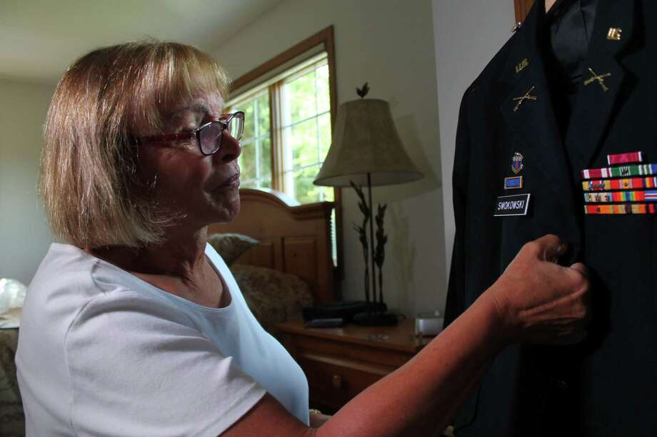 """Transgender Retired US Army Colonel Sheri Swokowski prepares her uniform on July 1, 2016, at her home in DeForest, Wisconsin.  Transgender personnel will no longer be barred from serving openly in the US military, the Pentagon announced on June 30, 2016. Lifting the ban on transgender service members is """"the right thing to do, and it's another step in ensuring that we continue to recruit and retain the most qualified people,"""" US Defense Secretary Ashton Carter told reporters.  / AFP PHOTO / derek henkleDEREK HENKLE/AFP/Getty Images Photo: DEREK HENKLE / AFP or licensors"""