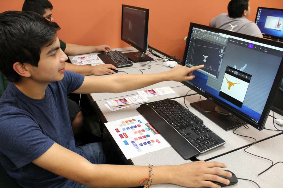 Laredo Community College student Phillip Bondoc explains the process used to create his very own 3D electronic solid model. The skill is covered in the Computer Aided Drafting and Design course, which is one of several Computer Technology programs offered at LCC. Photo: Courtesy