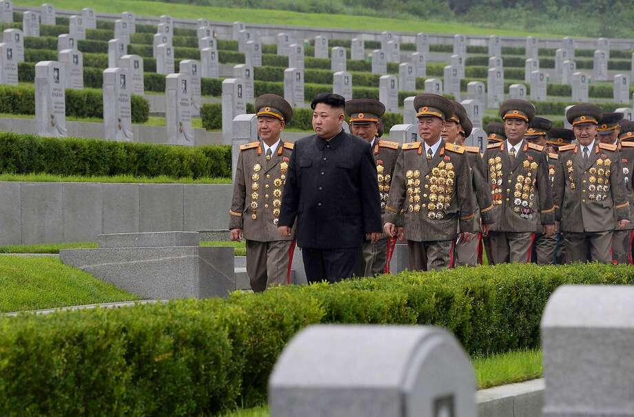 """This photo taken on July 27, 2017 and released on Juky 28, 2017 by North Korea's official Korean Central News Agency (KCNA) shows North Korean leader Kim Jong-Un (C) visiting the Fatherland Liberation War Martyrs Cemetery in Pyongyang.  / AFP PHOTO / KCNA via KNS AND AFP PHOTO / STR /  - South Korea OUT / REPUBLIC OF KOREA OUT   ---EDITORS NOTE--- RESTRICTED TO EDITORIAL USE - MANDATORY CREDIT """"AFP PHOTO/KCNA VIA KNS"""" - NO MARKETING NO ADVERTISING CAMPAIGNS - DISTRIBUTED AS A SERVICE TO CLIENTS THIS PICTURE WAS MADE AVAILABLE BY A THIRD PARTY. AFP CAN NOT INDEPENDENTLY VERIFY THE AUTHENTICITY, LOCATION, DATE AND CONTENT OF THIS IMAGE. THIS PHOTO IS DISTRIBUTED EXACTLY AS RECEIVED BY AFP.  / STR/AFP/Getty Images Photo: KCNA Via KNS AND AFP PHOTO/Getty Images"""