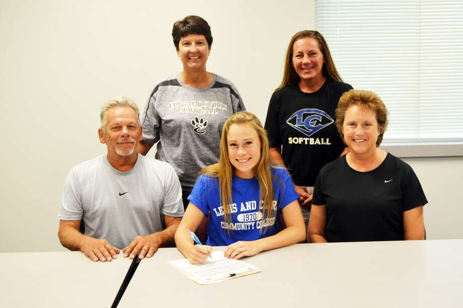 Edwardsville graduate Megan Pfeiffer, seated center, will play softball at Lewis and Clark Community College.