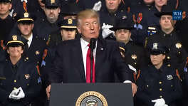 President Donald Trump speaks Friday, July 28, 2017, in Long Island, NY, about a crackdown on violent street gangs, particularly MS-13.