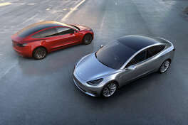 A Telsa Model 3 is shown in a promotional photo from Tesla, Inc.