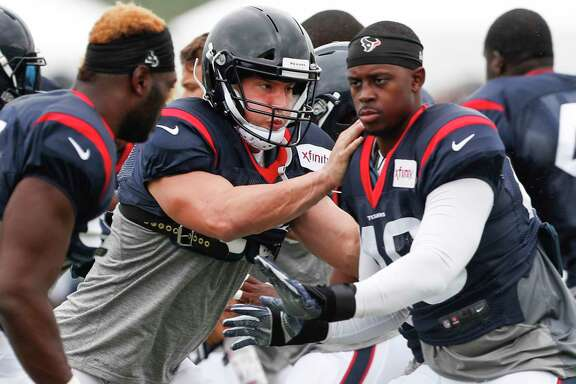 Houston Texans inside linebacker Brian Cushing, center, runs through the line during a drill during training camp at the Greenbrier on Friday, July 28, 2017, in White Sulphur Springs, W.Va.