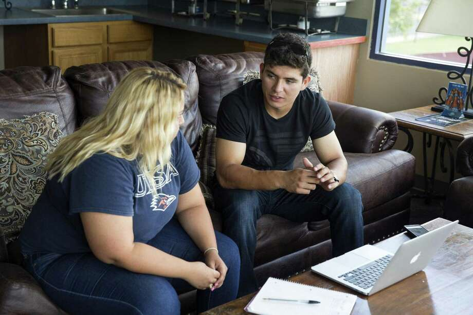 San Antonio Missions infielder Luis Urias talks with Melissa Gomez, a master's student studying ESL Education at UTSA, during an English as a second language class at Wolff Stadium in San Antonio on July 19, 2017. Photo: Ray Whitehouse /For The Express-News