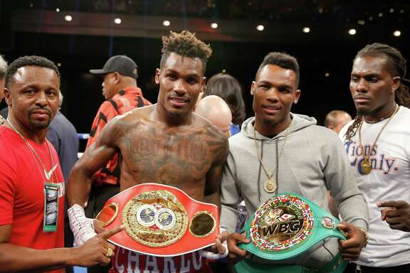 LAS VEGAS, NV - MAY 21:  Twin brothers IBF junior middleweight champion Jermall Charlo (L) and WBC super welterweight champion Jermell Charlo display their belts at The Chelsea at The Cosmopolitan of Las Vegas on May 21, 2016 in Las Vegas, Nevada.  (Photo by Steve Marcus/Getty Images)