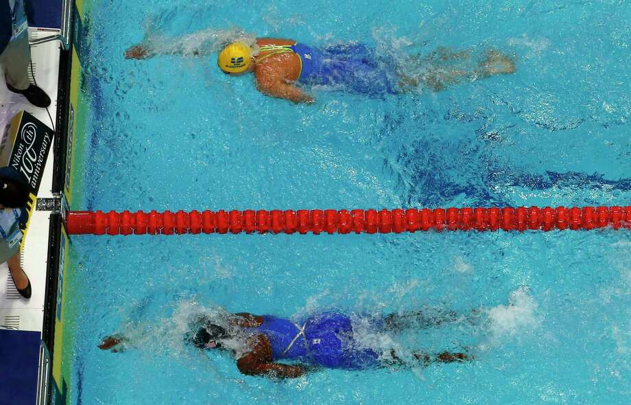 American Simone Manuel, bottom, wins the women's 100-meter freestyle final a touch ahead of Sweden's Sarah Sjostrom. Photo: Michael Sohn, STF / Copyright 2017 The Associated Press. All rights reserved.