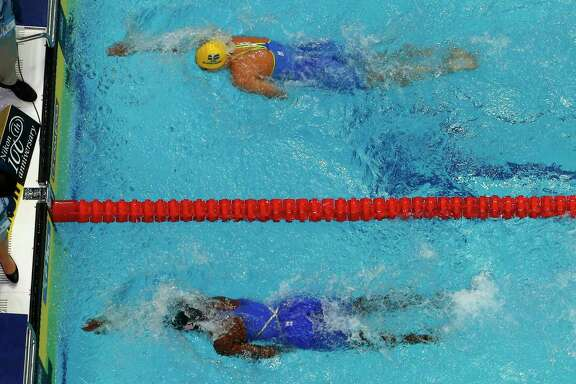American Simone Manuel, bottom, wins the women's 100-meter freestyle final a touch ahead of Sweden's Sarah Sjostrom.