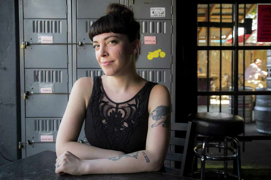 Bartender Alexa Philbeck works at Smarty Pants in the Georgetown neighborhood of Seattle, and shares her first name with Amazon's voice-activated device. Photo: Bettina Hansen /Seattle Times / Seattle Times