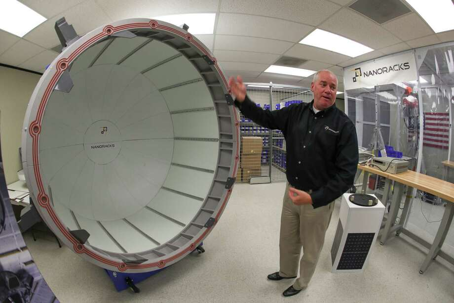 NanoRacks Project Manager Brock Howe uses a  full scale model to demonstrate how their commercial air lock system will work on he International Space Station Tuesday, July 25, 2017, in Webster.  Photo: Steve Gonzales, Staff / © 2017 Houston Chronicle