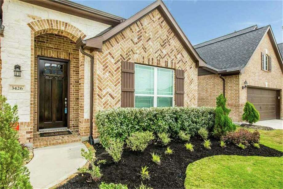 This Katy house is priced at $309,9000, that's roughly $118 per square foot.>>Click to see what roughly $300,000 buys in the areas surrounding Houston. Photo: Houston Association Of Realtors