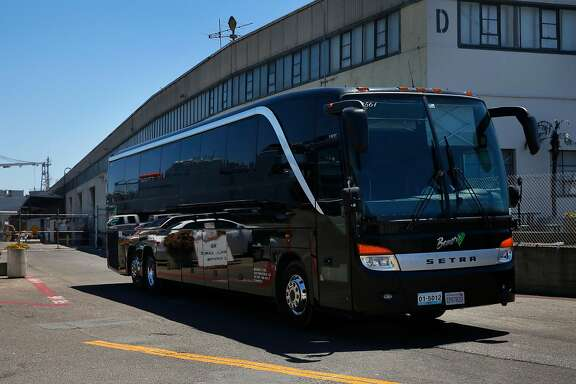 A bus leaves the Bauer's Intelligent Transportation facility July 27, 2017 in San Francisco, Calif.