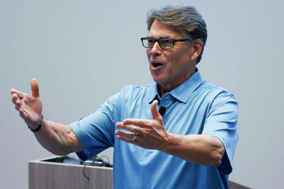 United States Energy Secretary Rick Perry talks to employees at Daikin Industries after taking a tour of the air conditioning manufacturing plant Friday, July 28, 2017 in Waller. Photo: Michael Ciaglo, Houston Chronicle / Michael Ciaglo
