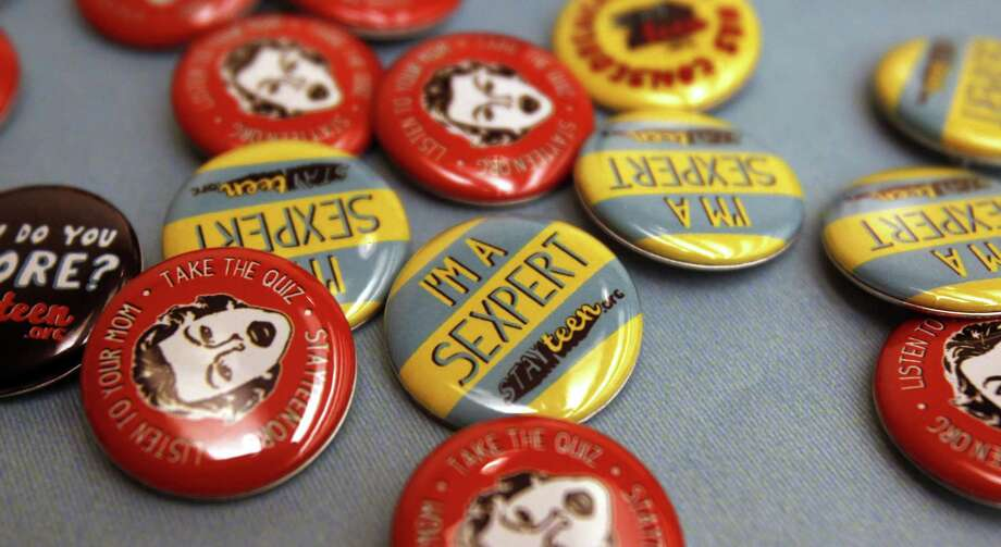 Buttons discouraging teen pregnancy mark National Day to Prevent Teen Pregnancy in 2012. Five years later, funding cuts jeopardize prevention programs, including delivery of sex education to 17,000 students in Bexar County. Photo: Express-News File Photo / Staff photo by Eric S. Swist