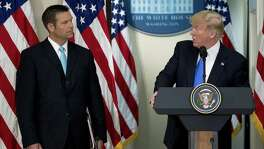 U.S. President Donald Trump speaks as Kris Kobach, Kansas secretary of state listens during the initial meeting of the Presidential Advisory Commission on Election Integrity in Washington, D.C. last week. Trump created the advisory commission in May, after claiming without evidence that 3 million people or more illegally voted for Hillary Clinton last year, but there is no evidence of that.