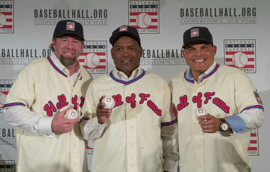 FILE - In this Jan. 19, 2017, file photo, Hall of Fame inductees Jeff Bagwell, left, Tim Raines, center, and Ivan Rodriguez, poses for a photo during a news conference, in New York. Bagwell, Raines, Rodriguez, Bud Selig and John Schuerholz each carved his own niche in major league baseball, and on Sunday they will receive the game's ultimate reward _ induction into the Hall of Fame. (AP Photo/Mary Altaffer) Photo: Mary Altaffer, STF / Copyright 2017 The Associated Press. All rights reserved.