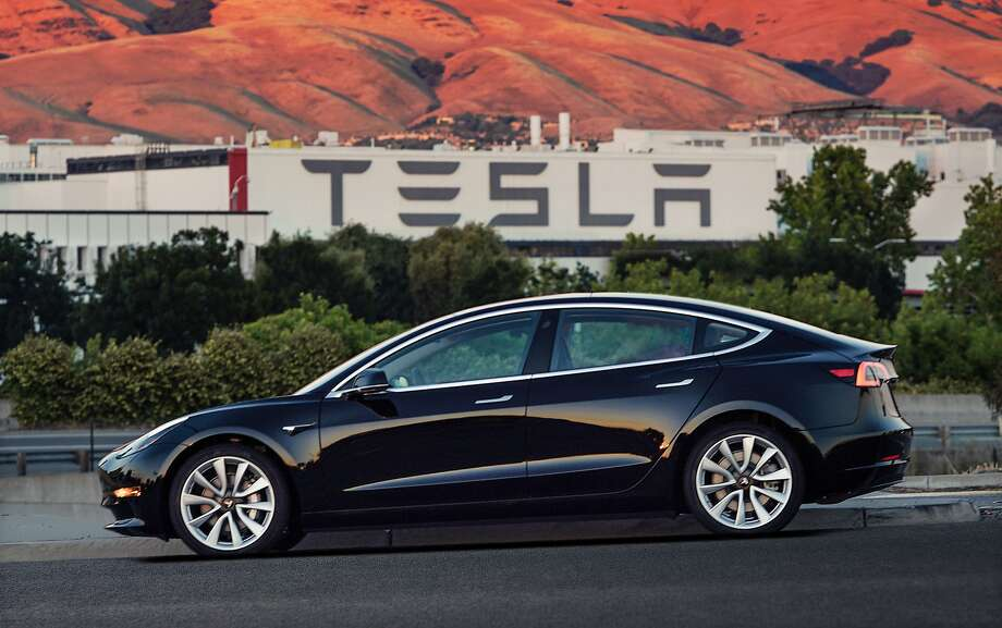 This undated image provided by Tesla Motors shows the Tesla Model 3 sedan. The electric car company's newest vehicle went to 30 employees Friday. Photo: Associated Press
