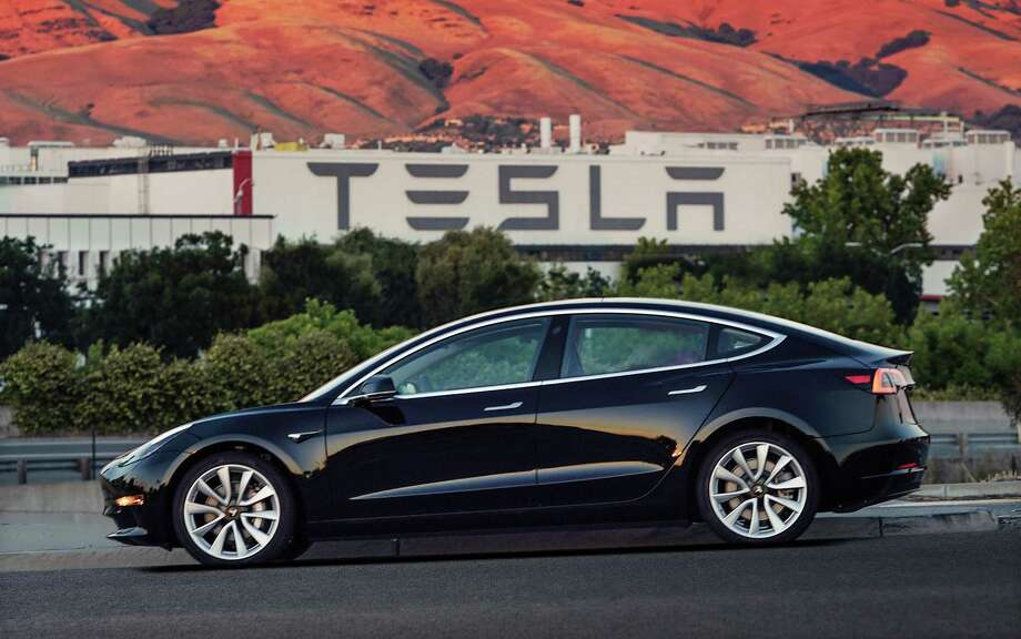 The Tesla Model 3, which is set to go to its first 30 customers Friday, is half the cost of previous models. Its $35,000 starting price and 215-mile range could bring hundreds of thousands of customers into Tesla's fold, taking it from a niche luxury brand to the mainstream. Photo: Courtesy Of Tesla Motors / Tesla Motors