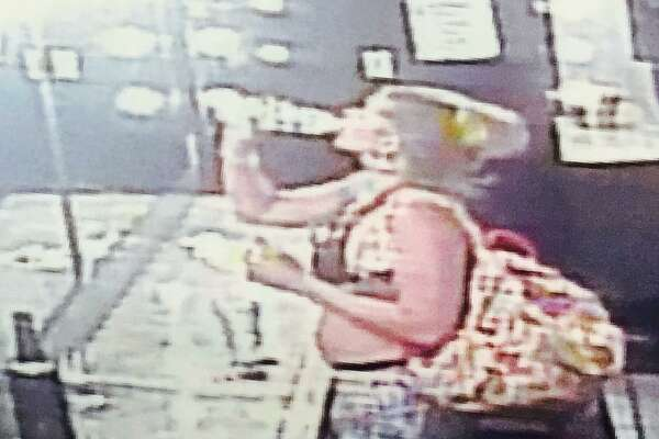 Amber Willemsen is shown on surveillance camera at her job at The Ritz strip club. Evidence photographed July 28, 2017 at Amber Willemsen's trial in Angleton. Willemsen is charged with intoxication manslaughter in connection with a June 12, 2016 head-on collision that killed Pearland Police Officer Endy Ekpanya.