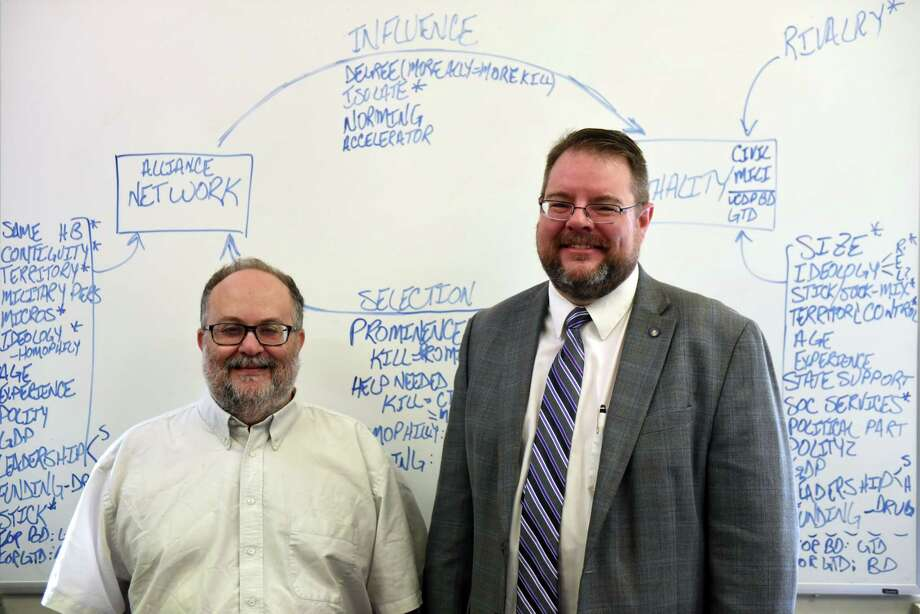 Professors Victor Asal, left, and Karl Rethemeyer, right, are pictured at the Rockefeller College of Public Affairs & Policy at the University at Albany on Friday, July 28, 2017, at the UAlbany downtown campus in Albany, N.Y. These two professors created a couple of databases called BAAD 1 and 2 that contain in depth info on hundreds of terrorist organizations and their relationships with each other and whether they are based on affection, ideology or just cold hard cash. (Will Waldron/Times Union) Photo: Will Waldron, Albany Times Union / 20041154A