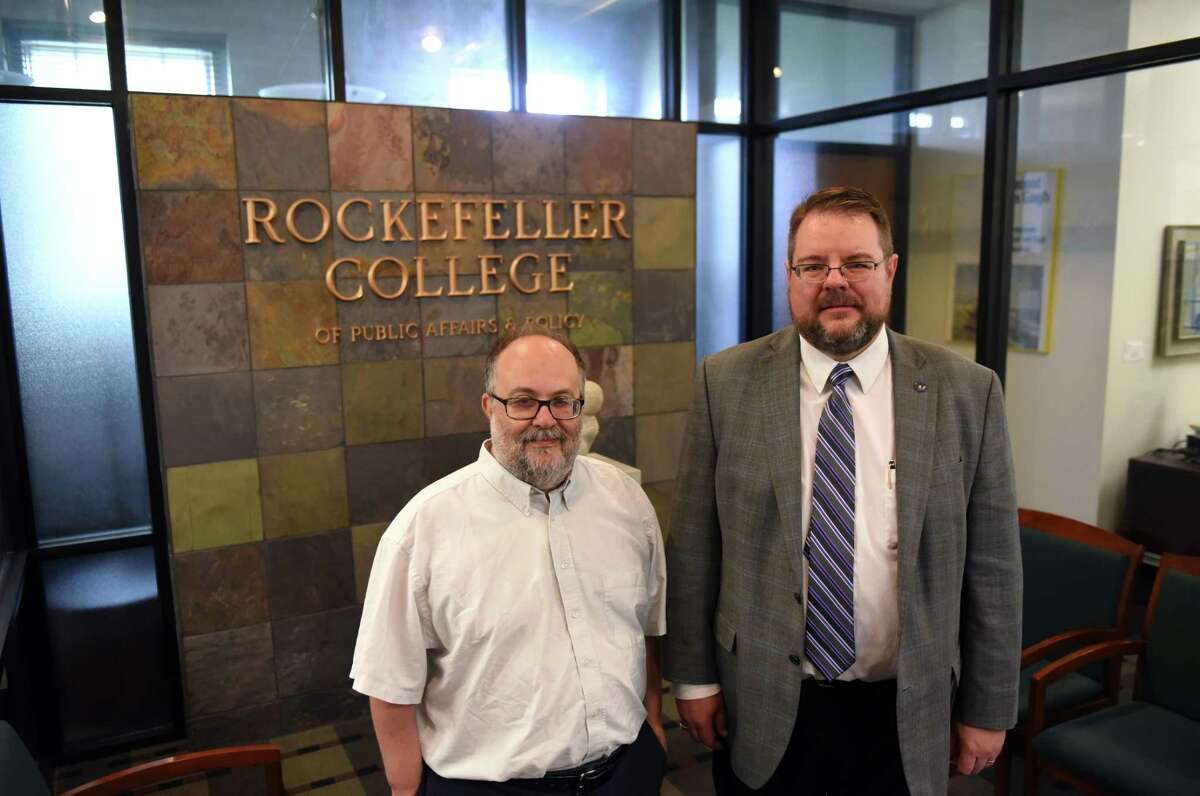 Professors Victor Asal, left, and Karl Rethemeyer, right, are pictured at the Rockefeller College of Public Affairs & Policy at the University at Albany on Friday, July 28, 2017, at the UAlbany downtown campus in Albany, N.Y. These two professors created a couple of databases called BAAD 1 and 2 that contain in depth info on hundreds of terrorist organizations and their relationships with each other and whether they are based on affection, ideology or just cold hard cash. (Will Waldron/Times Union)