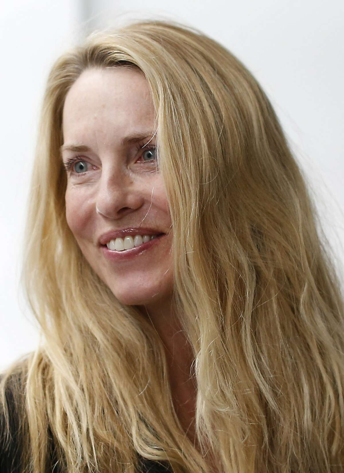 Laurene Powell Jobs, widow of late Apple founder and CEO Steve Jobs, is seen among the crowd after an Apple special event at the Yerba Buena Center for the Arts on March 9, 2015 in San Francisco, California. Apple Inc. announced the new MacBook as well as more details on the much anticipated Apple Watch, the tech giant's entry into the rapidly growing wearable technology segment as well