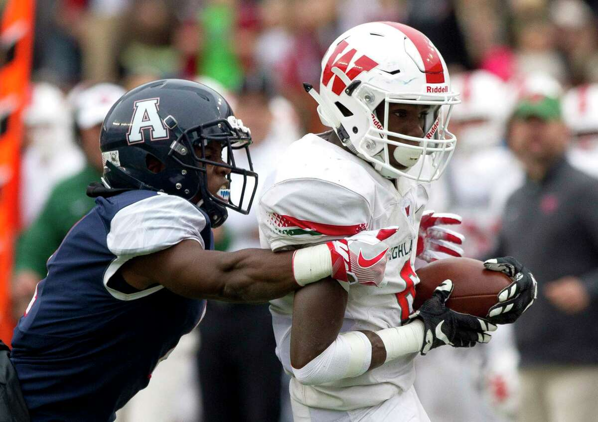 The Woodlands wide receiver Kesean Carter (6) picks up a 28-yard gain after catching a pass from quarterback Eric Schmid (3) during the first quarter of a Class 6A Division I state semifinal game at Darrell K Royal-Texas Memorial Stadium Saturday, Dec. 10, 2016, in Austin.