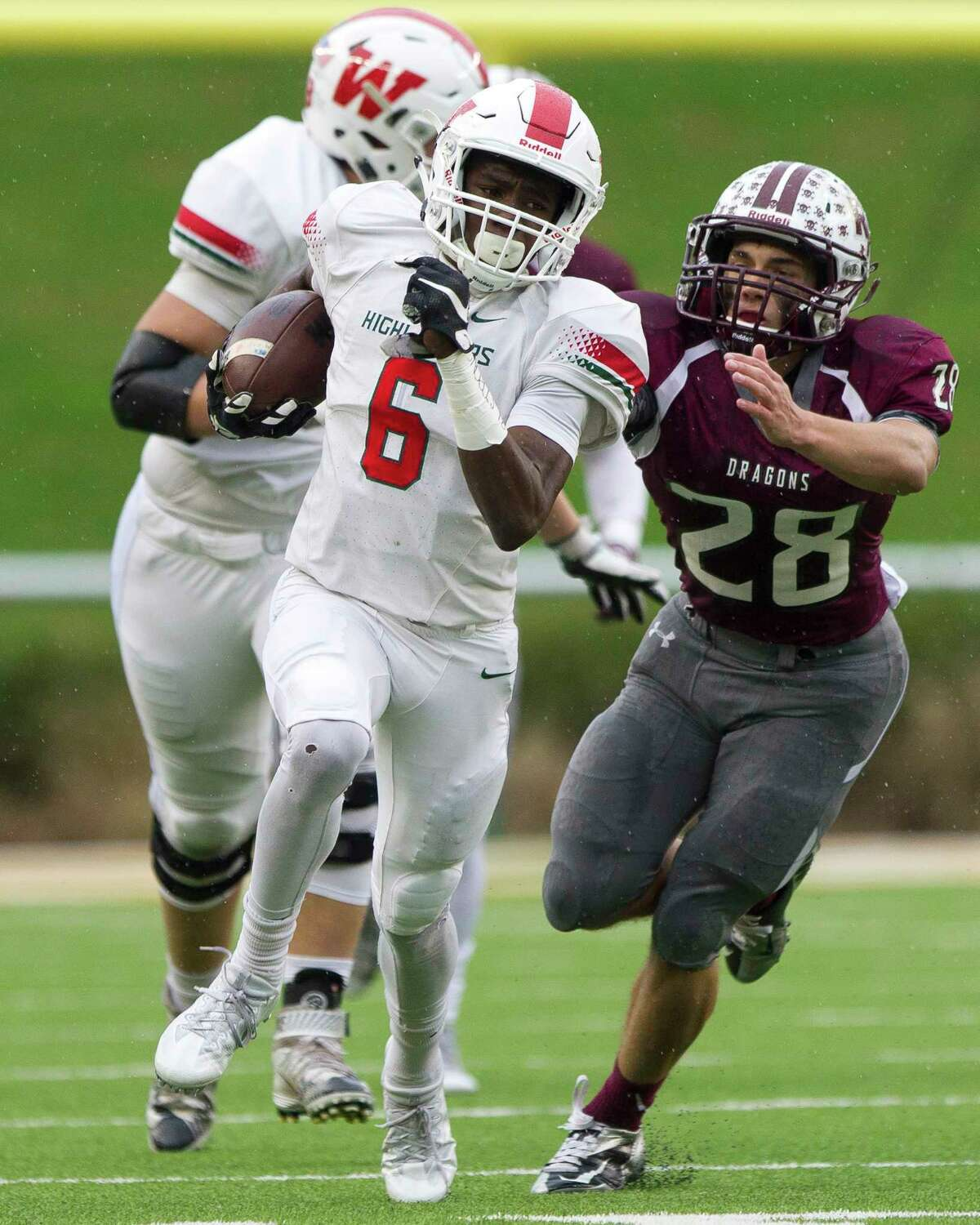 The Woodlands wide receiver Kesean Carter (6) was one of four members of the Highlanders' state-bound football team to be selected to the Associate Pressé?• Class 6A All-State team. Senior defensive end and Air Force commit Michael Purcell was selected to the first team, while quarterback Eric Schmid and linebacker Zach La Canfora joined Carter with honorable mention recognitions.