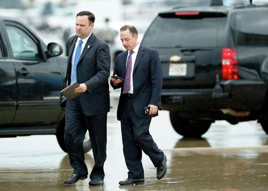 White House Director of Social Media Dan Scavino, left, walks with former White House Chief of Staff Reince Priebus steps off Air Force One as they arrive Friday, July 28, 2017, at Andrews Air Force Base, Md. Trump says Homeland Secretary Secretary John Kelly is his new White House chief of staff. (AP Photo/Alex Brandon) Photo: Alex Brandon, STF / Copyright 2017 The Associated Press. All rights reserved.