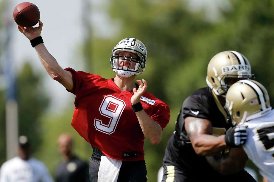 New Orleans Saints quarterback Drew Brees (9) throws the ball during NFL football training camp in Metairie, La., Friday, July 28, 2017. (AP Photo/Jonathan Bachman) Photo: Jonathan Bachman, FRE / FR170615 AP
