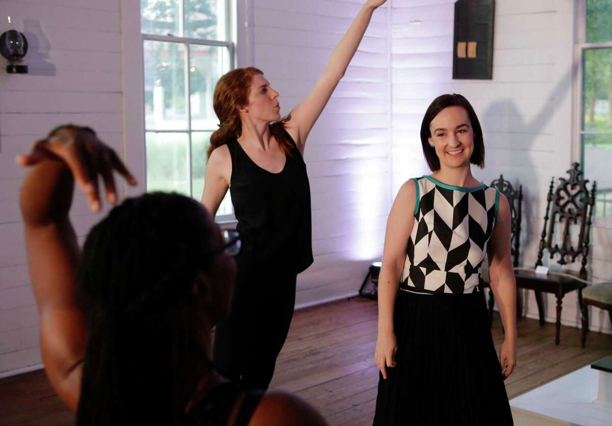 """Choreographer Lydia Hance, right, works with Brittny Bush, left, and Margaret Lewis, center, during rehearsals for """"Church."""""""