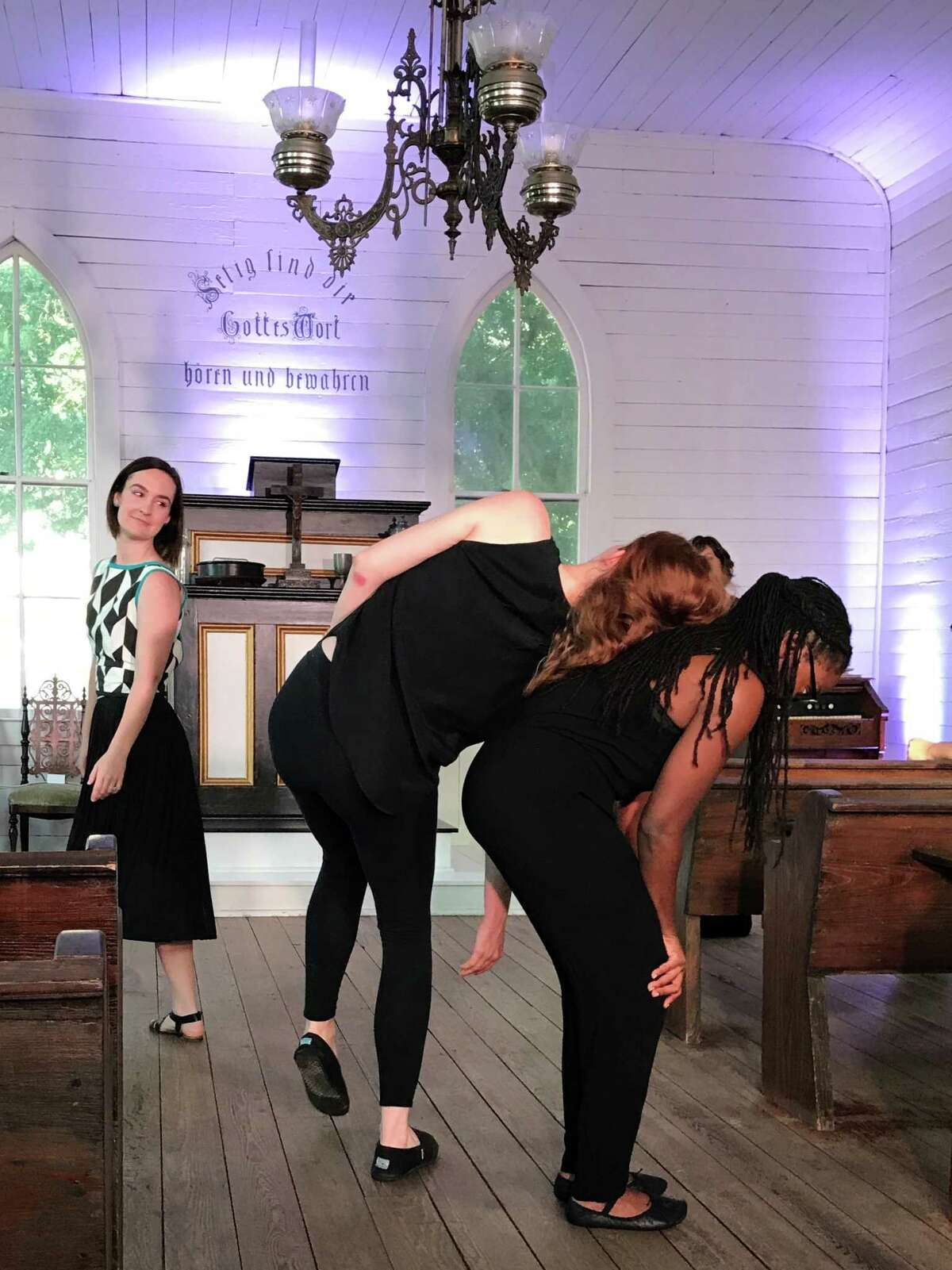 """Choreographer Lydia Hance, left, watches as actors Margaret Lewis, center, and Brittny Bush rehearse a modern dance move for Horse Head Theatre's production of """"Church."""""""