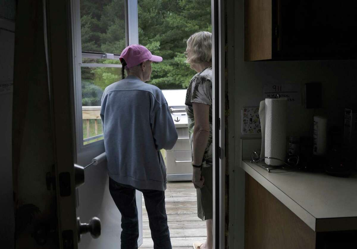 Sisters Bee Finkle, 61, left, and JoAnne Finkle, 66, of New Milford, say they were victims of a home invasion. They are standing at the back door where they say the perpatrator gained entry. Photo Thursday, July 27, 2017.
