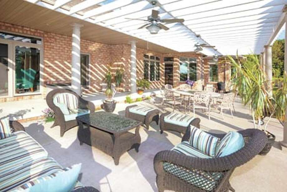 Everyone will love the style and shade of a Pergola at your home. Call American Home Improvement today to learn more. Photo: Copyright: James G Brey