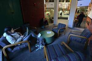 "Norwalk Community College students relax at the campus. NCC has implemented programs to combat ""summer melt,"" a phenomenon in which seemingly college-intending students, particularly those from low-income backgrounds, fail to enroll in college the fall after graduation."