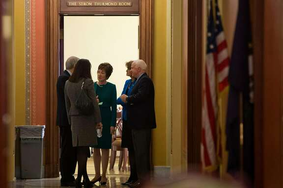Sen. Susan Collins, R-Maine, center, talks with, from left, Sen. Rob Portman, R-Ohio, Sen.. Kelly Ayotte, R-N.H., Collins, Sen.  Lisa Murkowski, R- Alaska, and Sen. John McCain, R- Ariz., on Capitol Hill in Washington, Friday, Oct. 11, 2013. House Republicans are offering to pass legislation to avert a default and end the 11-day partial government shutdown as part of a framework that would include cuts in benefit programs, officials said Friday. (AP Photo/ Evan Vucci)