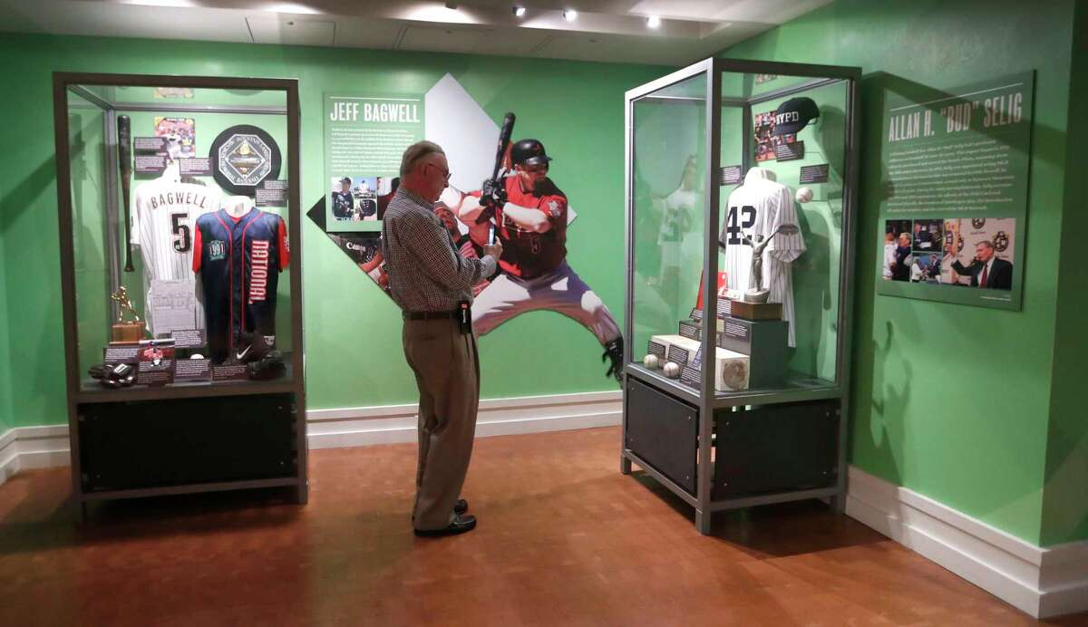 A visitor takes a photo of the Bud Selig exhibit, which is next to the Jeff Bagwell exhibit inside the Hall of Fame. Bagwell and Selig will be inducted into the shrine together, with 1994 a key season in both legacies.