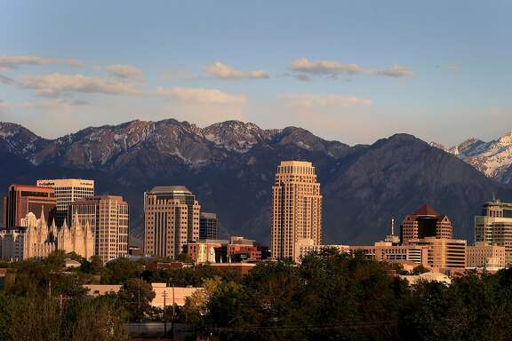 The Wasatch Range hovers over downtown Salt Lake City. Salt Lake City, Utah has made great strides in housing and taking care of its homeless population in the last few years.
