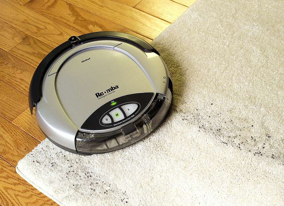 "(NYT9) UNDATED -- Sept. 25, 2002 -- CIR-GEEK-NOTES-3 -- It may look more like an oversize Frisbee than Rosie the robotic housekeeper of ""Jetsons"" fame, but Roomba is, in fact, a fully automatic robot vacuum cleaner for homes and small offices. Its maker, iRobot,  bills this seven-pound $199 sweeper as the Intelligent FloorVac. (The New York Times) Photo: NY TIMES, NYT"