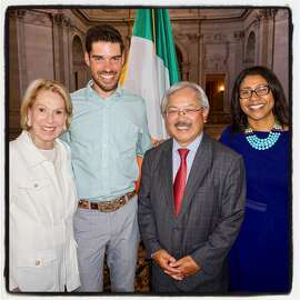 Charlotte Shultz (left) with runner Chris Mocko, Mayor Ed Lee and Supervisor London Breed at City Hall. July 13, 2017.