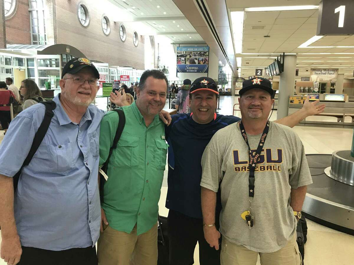 From left, Tom Ellerson, Kevin Foote, Mike Bernard and Steve Peloquin are Astros fans passing through Albany International airport on Friday, July 28, 2017, bound for baseball's Hall of Fame weekend. (Jason Franchuk / Times Union)