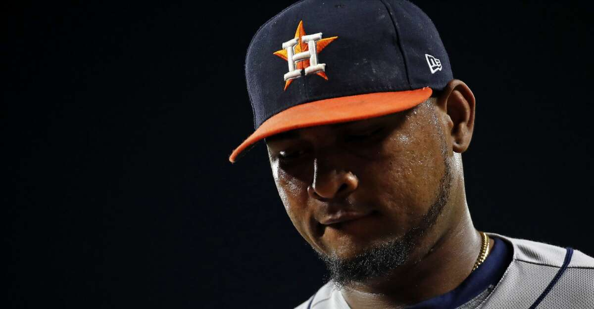 Houston Astros relief pitcher Michael Feliz walks off the field between innings of a baseball game against the Baltimore Orioles in Baltimore, Friday, July 21, 2017. (AP Photo/Patrick Semansky)