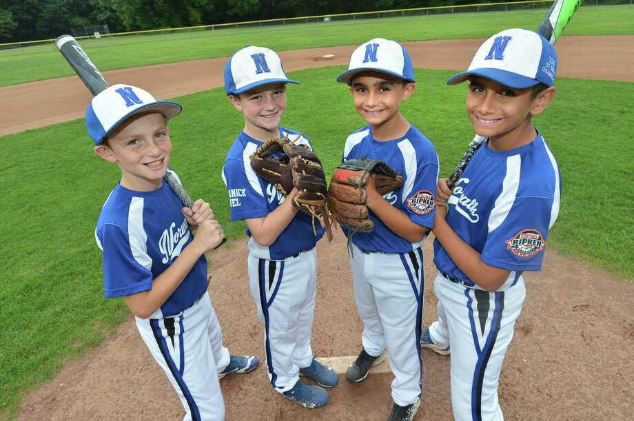L-R Brian Weiss with the Norwalk Cal Ripken All Stars 11's his brother Matthew with the 9's. Kosta Panagiotidis with the 9's and his brother Taso with the 11's , on the mound at Ned devine Field on Thursday July 27, 2017 in Norwalk Conn. Photo: Alex Von Kleydorff / Hearst Connecticut Media / Norwalk Hour