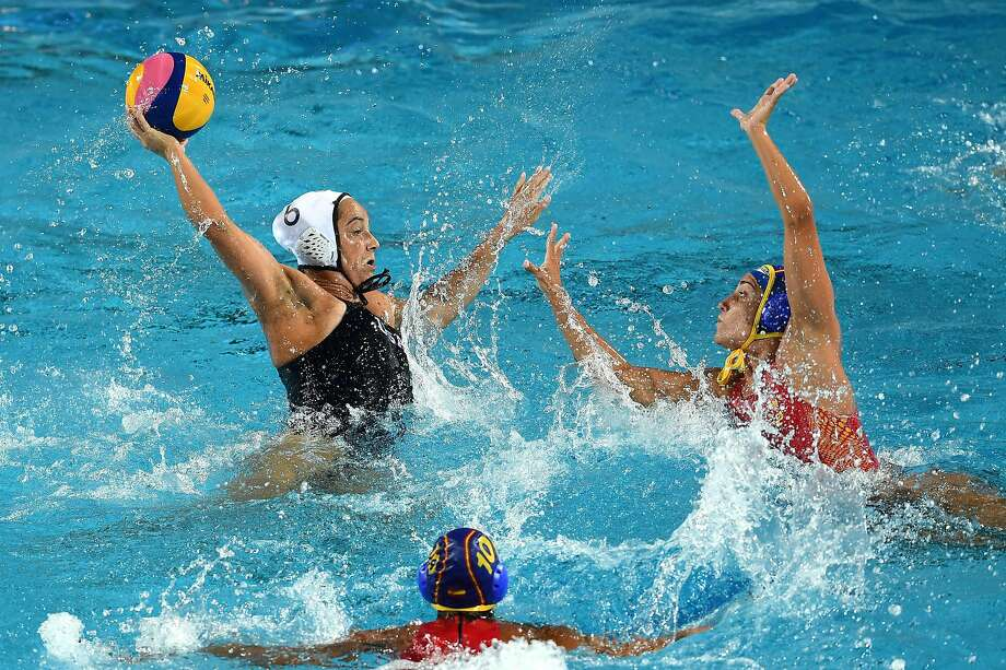 Former Stanford player Margaret Steffens shoots past Spain's Helena Lloret in the gold medal game. Photo: Laurence Griffiths, Getty Images